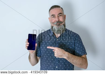 Large Bearded Caucasian 40-45 Year Old Hipster In Blue Shirt Looking Straight Ahead And Showing Blac