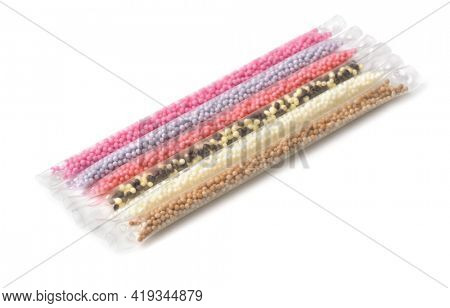 Various milk flavoring straws isolated on white