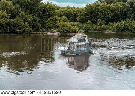 Light-engine Boat Float Floating On The River .