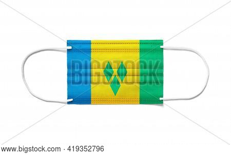 Flag Of Saint Vincent And The Grenadines On A Disposable Surgical Mask. White Background Isolated