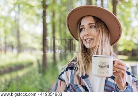 Young Stylish Caucasian Woman 30-35 Years Old Wearing Casual Clothing Shirt And Cowboy Hat Enjoys Li