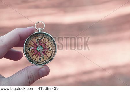 Old Classic Navigation Compass In Hand On Abstract Background As Symbol Of Tourism With Compass, Tra