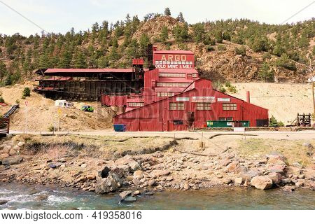 April 25, 2021 In Idaho Springs, Co:  Historical Argo Mine Besides A River Which Provides Tours To T