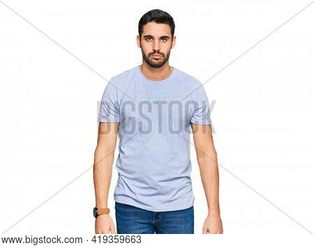 Young hispanic man wearing casual clothes depressed and worry for distress, crying angry and afraid. sad expression.