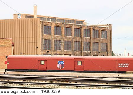 April 26, 2021 In Cheyenne, Wy:  Vintage Freight Rail Cars On A Railroad Track At The Union Pacific