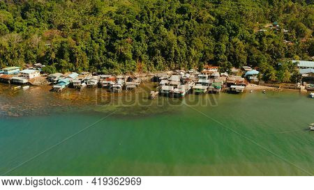 Houses Community Standing In Water In Fishing Village. City Port On Balabac Island, Palawan, Philipp