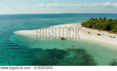 Travel Concept: Sandy Beach On A Tropical Island With Palm Trees By Coral Reef Atoll. Patawan Island