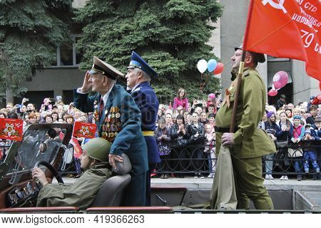 Veterans Moving By Car On Vctory Parade. Celebration Of The 70th Anniversary Of The Victory Day, Pya