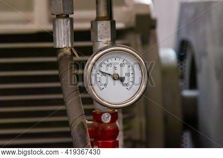 A Close-up Pressure Gauge In A Modern Factory.