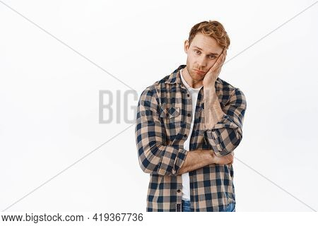 Portrait Of Bored Redhead Man, Looking Gloomy And Reluctant, Feeling Upset, Lean Head On Hand And St