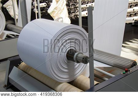 The Resulting Polypropylene Sleeve For The Manufacture Of Bags Is Wound On Large Reels. Drum For Win