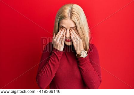 Young blonde woman wearing casual clothes rubbing eyes for fatigue and headache, sleepy and tired expression. vision problem