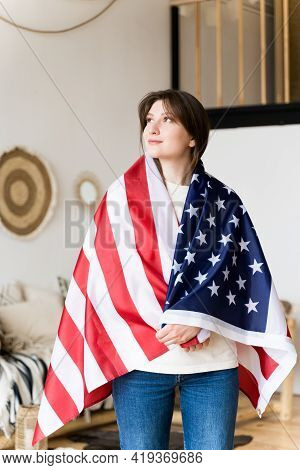 Patriot With The National Flag Of Us. A Symbol Of American Independence. Democracy, Pride And Freedo