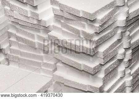 A Pile Of White Polystyrene Industrial Foam Material Storage On Warehouse.