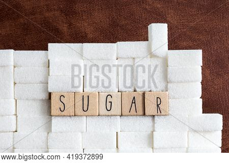 Sugar Cubes Wall With The Text Sugar On Brown Natural Background Texture, Health,diabetes,medical,su