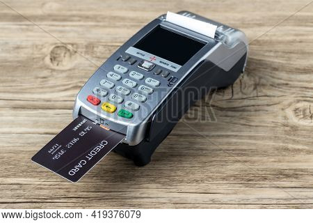 Credit Card Swiping Machine To Pay. Credit Card Swipe Through Terminal For Payment In Cafeteria. Cre
