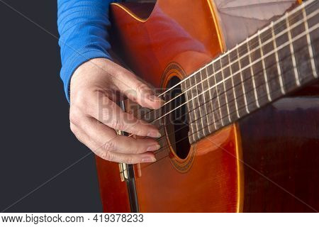 Male Guitarist Hands With Nails While Playing Music. Classical Guitar