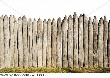 Wooden Fence From Logs Isolated On White Background. Fence From A Stockade Fence On White.