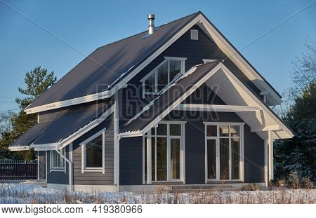 Construction Of Country Cottages Made Of Logs And Timber In A Green Area. Cozy Gray Eco-friendly Hou