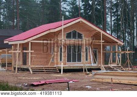 Construction Of A Country Cottage Made Of Logs And Timber In A Green Area. Cozy Eco-friendly House M