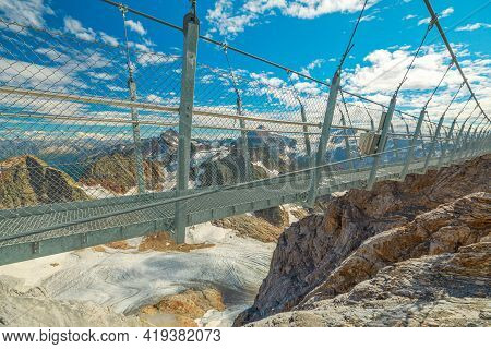 Titlis Suspension Bridge Of Steel Crossing The Peak On Top Of Titlis Glacier In The Uri Alps. Canton