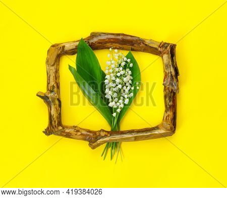 Greeting Card For Mother's Day With Bouquet Of Tender Lilies Of The Valley With Wooden Frame  On Yel