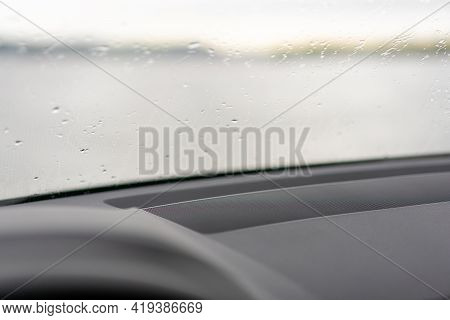 Raindrops On The Windscreen, Windshield, Or Car Window. View From Inside The Car