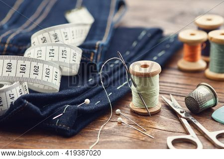 Shortening Jeans. Measuring Tape, Scissors, Spools Of Thread, Thimble, Including Pins And Chalk On T