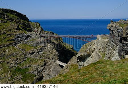 Tintagel Bridges Agaisnt Background Of A Deep Blue Sea. The Upper And Lower Bridges Are Visable As A