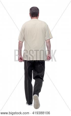 in full growth. a man in a light t-shirt striding forward.
