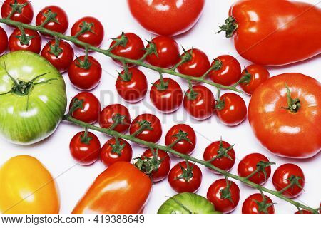 Heirloom Tomatoes Also Known As Heritage Tomatoes In A White Background