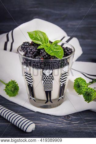 Traditional Italian Dessert Panna Cotta With Fresh Blackberries On A Dark Wooden Background