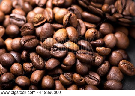 Coffee Beans Texture. Coffee In Beans On Dark Background. Food Background Of Coffee Beans. Abstract