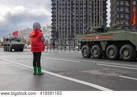 May 4, 2021, Russia, Moscow. Rehearsal Of The Victory Parade In The Great Patriotic War. A Child Loo