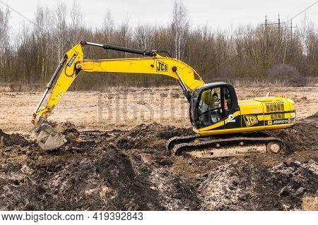 Belarus, Minsk Region - December 11, 2019: Construction Worker Man On An Crawler Excavator Equipment