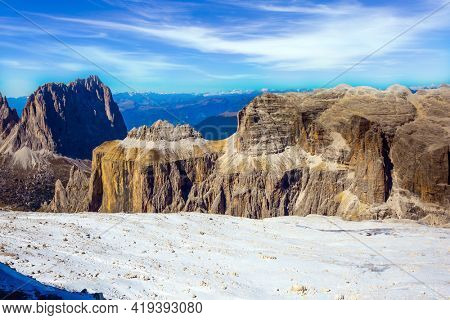 Warm sunny day in the Alps. The Passo-Pordoi pass. Pordoi is a mountain pass of the Dolomites, located between the Sella mountain range and the Marmolada mountain