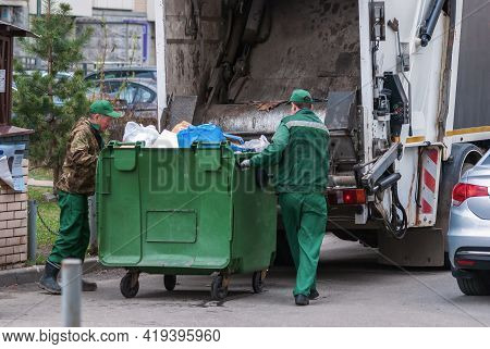 Garbage Men Operating Garbage Truck, Solid Household Waste Collection, Moscow, April 2021