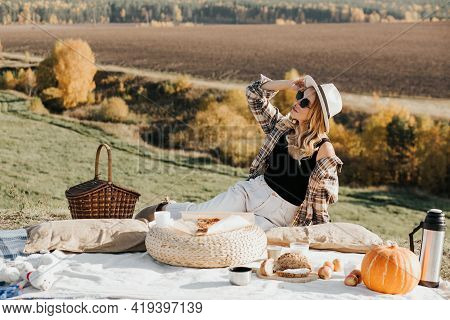 Blonde Woman Resting In Nature Alone. A Picnic Alone. Communication At A Distance. Nice View From Th