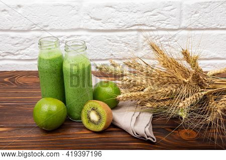 Glasses With Organic Smoothie And Straw. Detox Diet Concept. Jars Of Healthy Green Smoothie With Fre