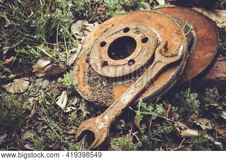 Rusty Brake Discs For Cars. Old Car Parts. Replacing Old Brake Discs With New Ones. Car Repair Shop.