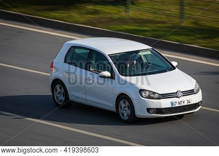 Alanya, Turkey  - April 13  2021:    White Volkswagen Polo     Is Driving Fast On The Street On A Wa