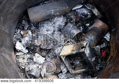 Burnt Trash. Remains Of Burnt Garbage. Household Waste. Waste Disposal. Garbage In The Barrel. Dispo