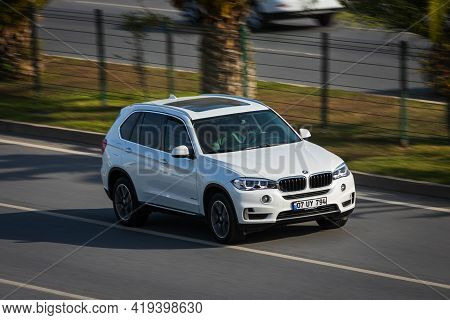 Alanya, Turkey  - April 13  2021:    White Bmw X5   Is Driving Fast On The Street On A Warm Summer D