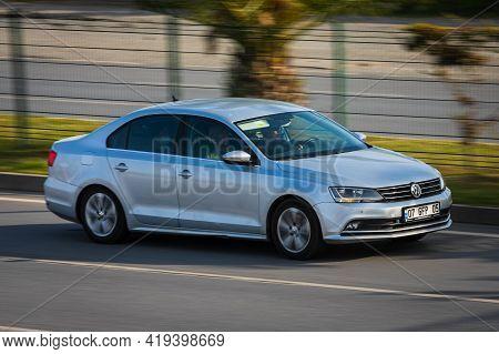 Alanya, Turkey  - April 17  2021:    Silver Volkswagen Jetta   Is Driving Fast On The Street On A Wa