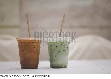 Iced Matcha Latte And Iced Mocha On Table At Meeting Room