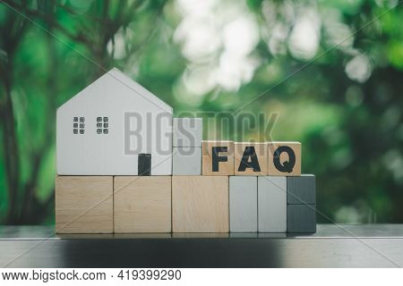 Wooden Blocks With The Word Faq Place With White Home. The Concept Of Faq About House Problems. Inst