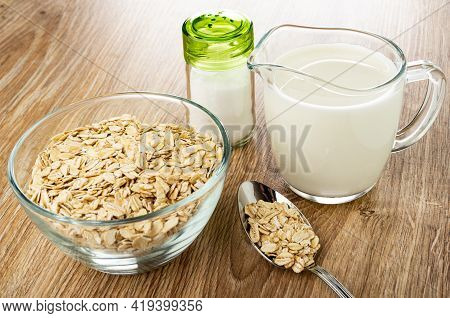 Salt Shaker, Transparent Bowl With Raw Oat Flakes, Pitcher With Milk, Metallic Spoon With Oat Flakes