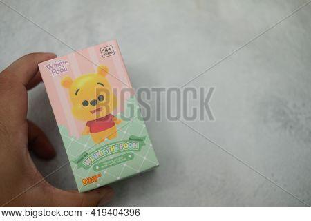 Samut Prakan , Thailand - May 5, 2021 : Hand Keep Of Winnie The Pooh Figures Mystery Box Blind Box C