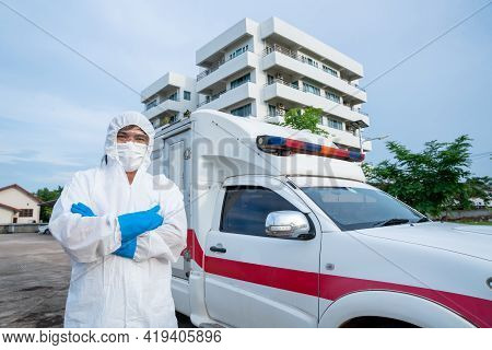 Doctor Nurse Staff Wear Ppe In Front Of The Ambulance With Protective Suit, Mask Gloves At Ambulance