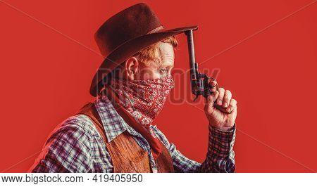 Portrait Of A Cowboy. West, Guns. Portrait Of A Cowboy. American Bandit In Mask, Western Man With Ha
